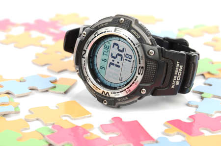 Puzzle and digital watch photo