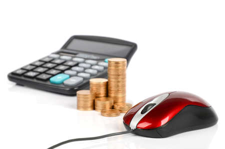Computer mouse, calculator and coins photo