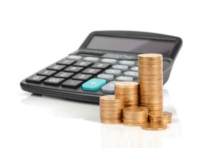 Calculator and coins photo