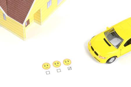 Toy car,model house and emoticon Stock Photo - 12224748