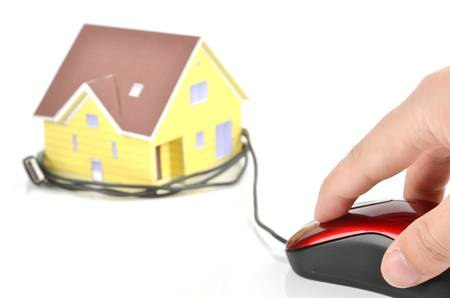 Model house and computer mouse photo