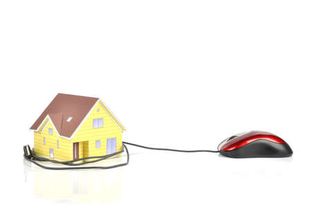 house mouse: Model house and computer mouse Stock Photo