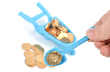 gold shovel: Toy pushcart and coins