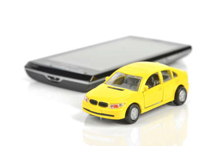 Smart phone and toy car Stock Photo - 12237245