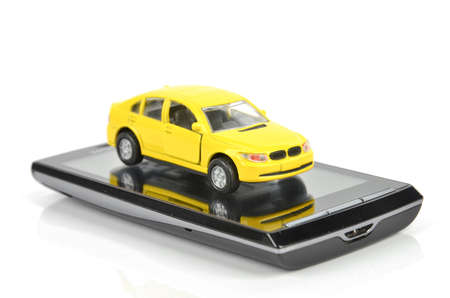Smart phone and toy car photo