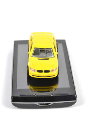 Smart phone and toy car Stock Photo - 12237308