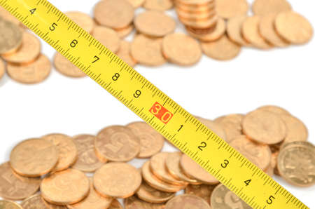 Steel tape and coins photo