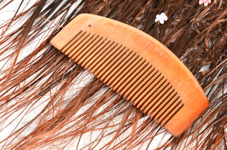 Wood comb and hair photo