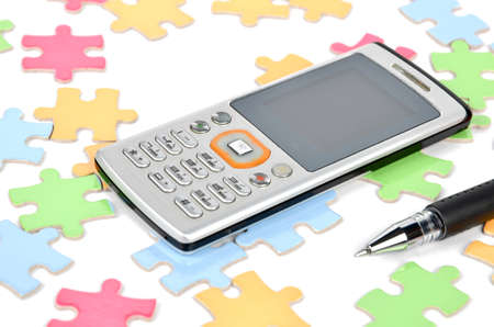 Mobile phone and puzzle photo