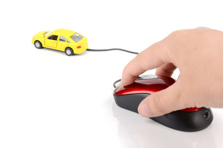 Computer mouse and toy car photo