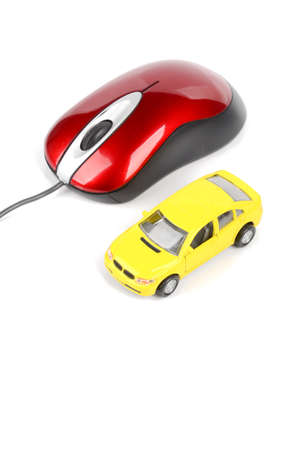 Toy car and computer mouse photo