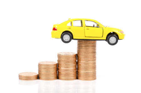 Toy car and coins Stock Photo - 12290079