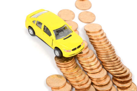 Toy car and coins Stock Photo - 12291529