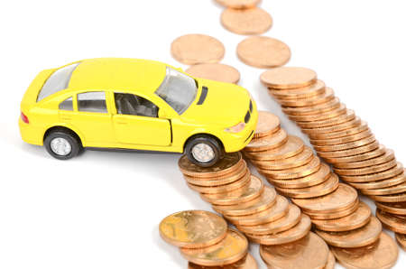 Toy car and coins Stock Photo - 12291713