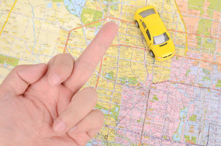 Toy car and map with finger Stock Photo - 12290238
