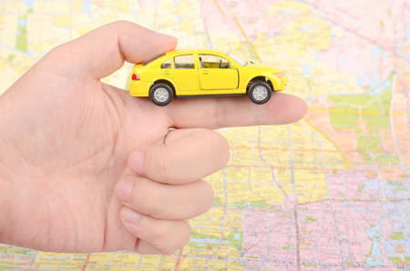 Toy car and map with finger Stock Photo - 12290392
