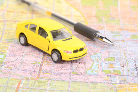Toy car and map with pen photo
