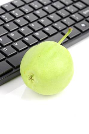 Pear and computer keyboard photo