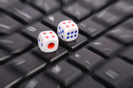 Dices on keyboard photo