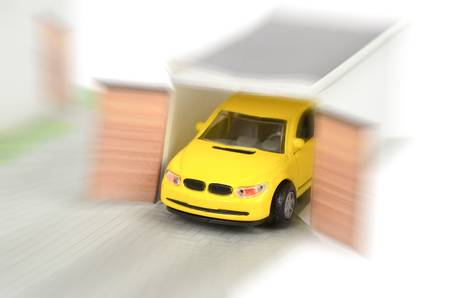 Toy car and model house photo