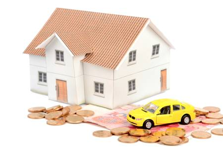 yuan: Toy car and model house with chinese yuan Stock Photo