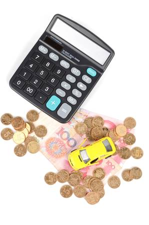 Toy car and calculator with chinese yuan photo