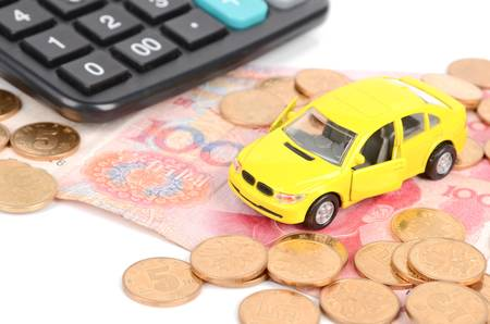 Toy car and calculator with chinese yuan Stock Photo - 12289771