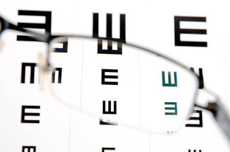 Glasses and eye chart Stock Photo - 12289484