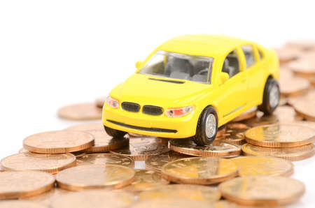 car bills: Toy car and coins Stock Photo