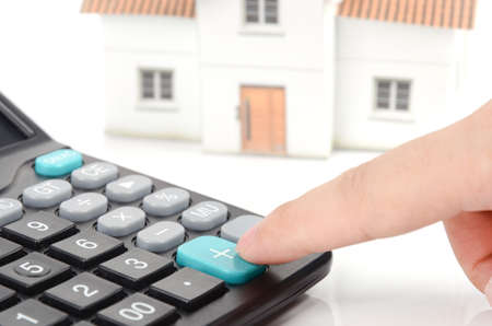 Calculator and house model photo
