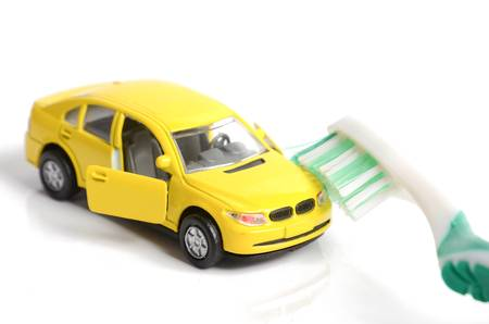 Toy cars and toothbrush photo