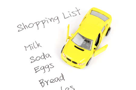 Toy car and shopping list photo