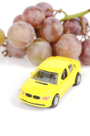 Toy car and grape photo