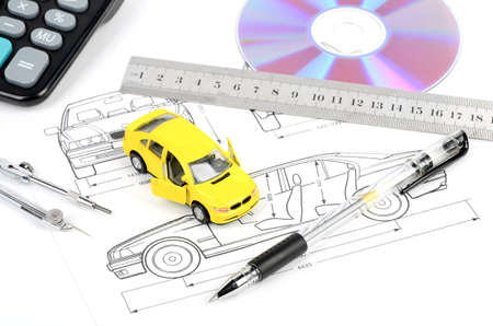 Toy car and blueprint photo