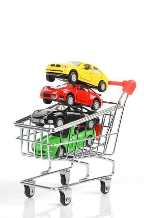 Shopping cart and toy car photo