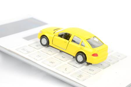 Toy car and calculator photo