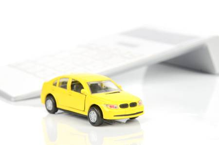 Toy car and calculator Stock Photo - 12445861