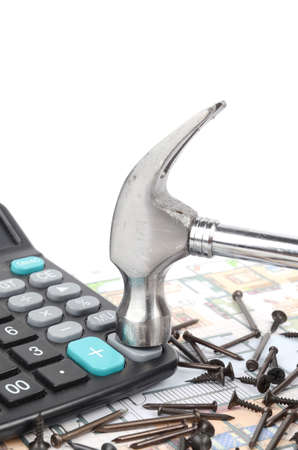 Calculator,hammer and nails on blueprint photo