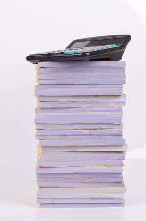 Stack of documents and calculator photo