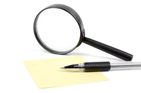 investigating: Magnifier,pen and notepaper