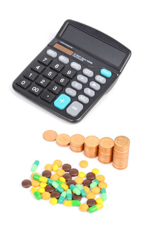 Medicine,coins and calculator photo