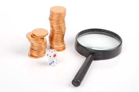 Coins,magnifier and dices photo