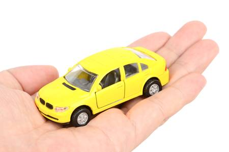 Toy car and hand photo