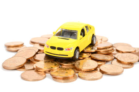Yellow car and coins photo