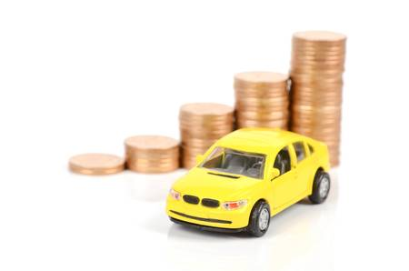 auto leasing: Yellow car and coins