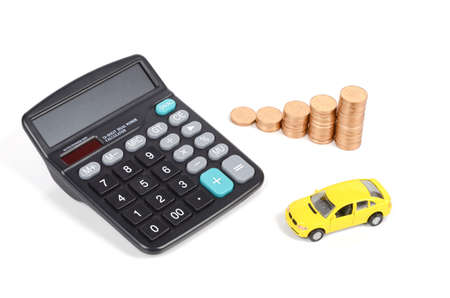 Calculator,coins and toy car Stock Photo - 12500494