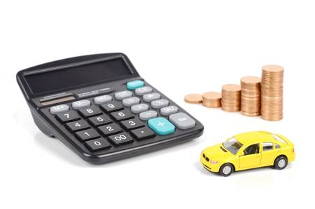 Calculator,coins and toy car Stock Photo - 12500052