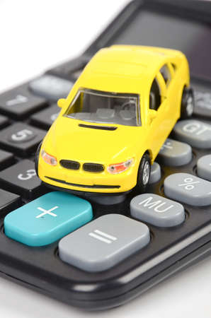 Calculator and toy car photo
