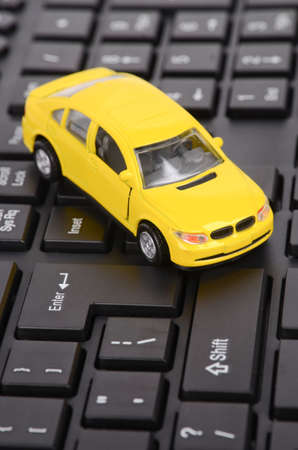 Toy car on keyboard photo