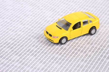 Toy car on binary code Stock Photo